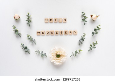 Hello Wednesday  words on white marble background