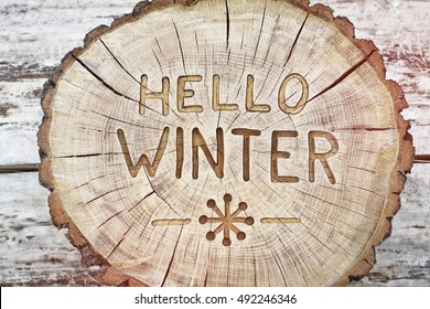 Hello winter. Carving wood for your design. Congratulatory background