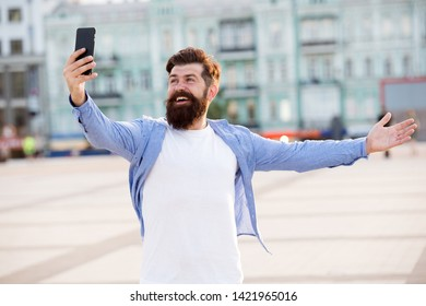 Hello world. Man taking selfie photo smartphone. Streaming online video call. Mobile internet. Tourist capture happy moment for blog. Hipster mobile phone blogger. Blog online content. Personal blog.