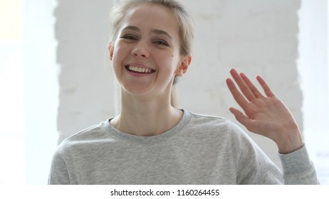 Hello, Young Woman Waving Hand to Welcome
