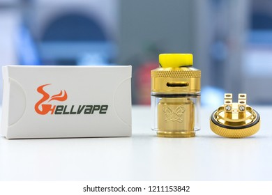 the hellvape dead rabbit rta in rose gold resting on top of a white table
