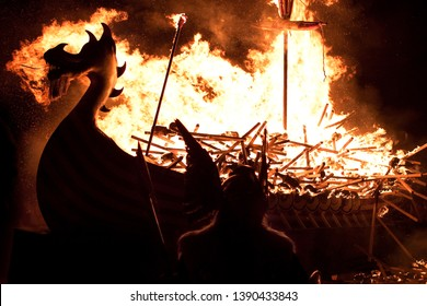 Up Helly Aa burning galley ship and viking silhouetted against the inferno. Up Helly Aa is a viking fire festival unique to the Shetland Isles, North of Scotland, UK.