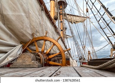 helm or rudder of a sailboat or deck of a sailboat with all the ropes ,sails ,helm or steering wheel of a sailboat