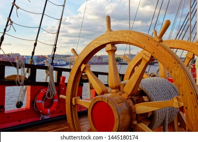 Helm wheel of an old wooden sailboat. Details of the deck of the ship.