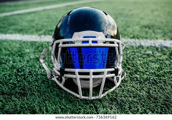 helmet for american football on the grass