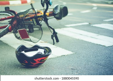Helmet and bike lying on the road on a pedestrian crossing, after accident