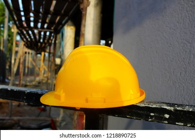 Helmet Builder Worker (Engineer) on the background of a building under construction. Construction site in Israel