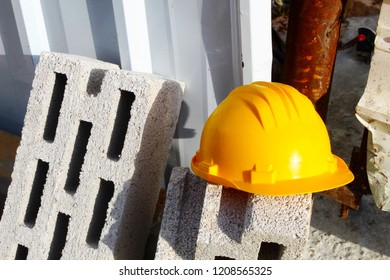 Helmet and Ceramsite Blocks (Lightweight Block) at the entrance to the construction site. Construction safety and Storing materials