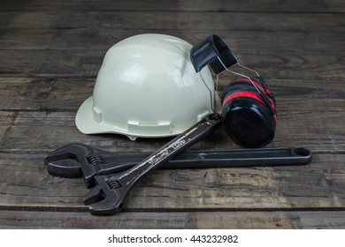 Helmet, ear noise, wrench.