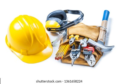 helmet earphones and toolbelt with construction tools isolated on white