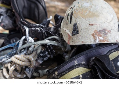 helmet with rope and tools for industry alpinism job