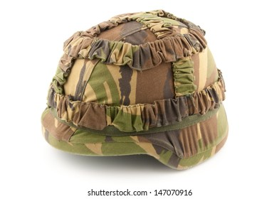 A helmet of a soldier with Dutch woodland camouflage