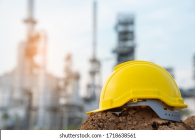 Helmet worker at refinery construction site