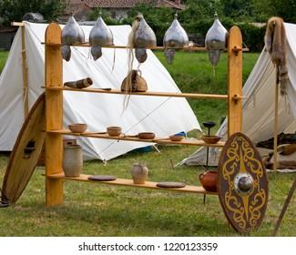 Helmets, shields, vases and amphoras in an ancient celtic encampment
