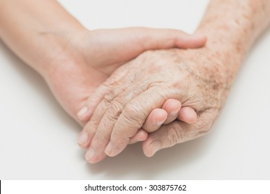 Help concept,The helping hands for elderly home care, Holding hand, noise and film grain style.