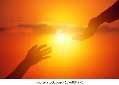 Help hand concept on sunset background