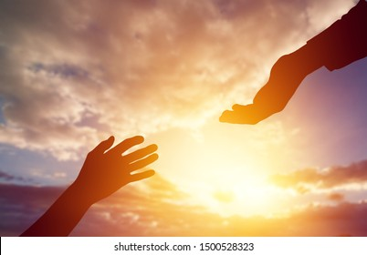 Help hand on sunset background