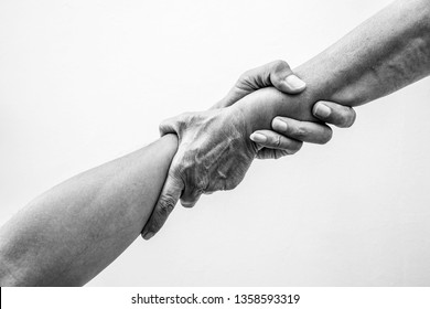 Help hands holding together in monochrome color representing friendship, partnership, help and hope, donation, assistance.