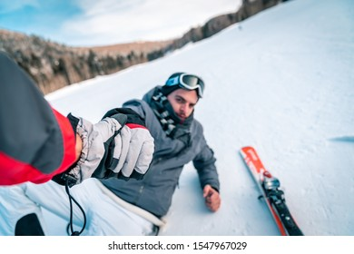 Help me get up! Skiiing injury. I fell down while skiing - Stock Photo