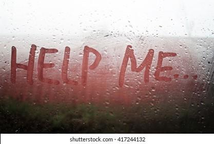 """The """"Help Me"""" inscription on the sweaty glass"""