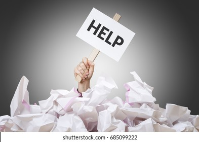 Help placard in hand with crumpled paper pile.
