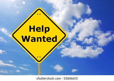 help wanted concept with yellow road sign and copyspace