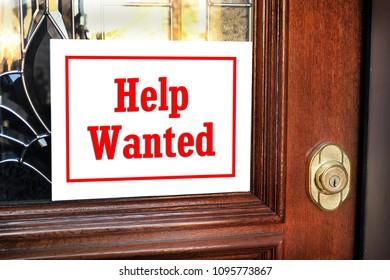 Help wanted sign on front door.