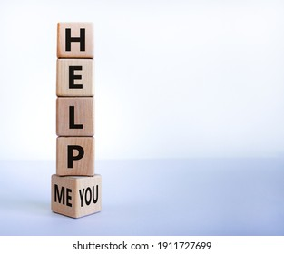 Help you or me symbol. Turned wooden cubes and changed words help me to help you. Beautiful white background, copy space. Business, motivational and help you or me concept.