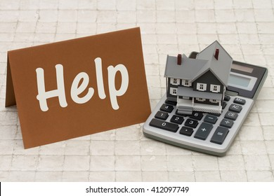 Help with Your Mortgage,  A gray house, brown card and calculator on stone background with text Help