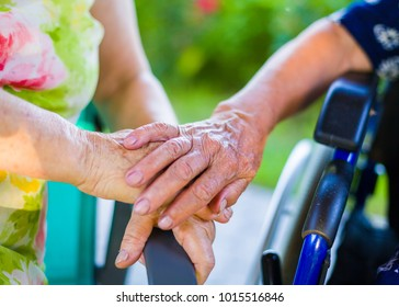 Helpful care for wrinkled hand of woman with disability.