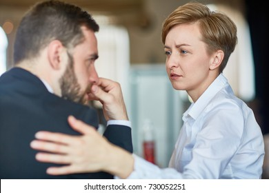 Helpful colleague comforting frustrated businessman in trouble