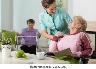 Helpful nurse working in old people's home