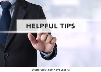 HELPFUL TIPS CONCEPT Businessman hands touching on virtual screen and blurred city background
