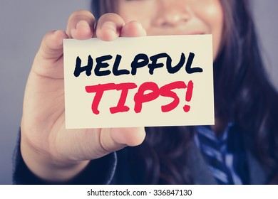 HELPFUL TIPS! message on the card shown by a businesswoman, vintage tone