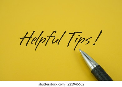 Helpful Tips! note with pen on yellow background