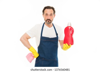 Helping about the house. Senior man holding bottle of laundry detergent or dish soap. Mature man doing household service. Household laundering. Household worker. Providing household service.