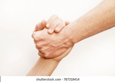 Helping hand concept. Gesture, sign of help and hope. Two hands taking each other. Isolated