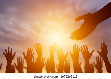 Helping hand concept. Human outstretched hand and peoples hands