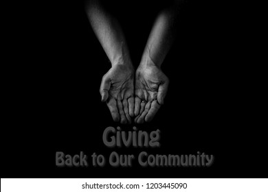"Helping hand concept, Man's hands palms up, giving care and support, reaching out, "" Giving back to our community"", word cloud"