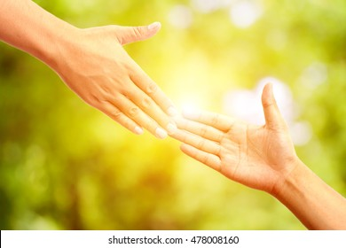 helping hand concept,Two hands reaching toward each other on abstract background
