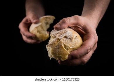 Helping hand giving a piece of bread. Man giving Bread, Helping Hand Concept.
