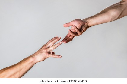 Helping hand outstretched, isolated arm, salvation. Close up help hand. Two hands, helping arm of a friend, teamwork. Helping hand concept and international day of peace, support. Closeup, power.