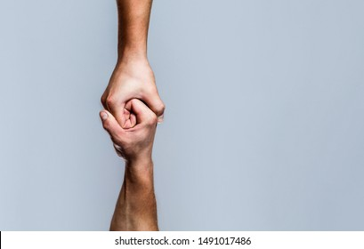 Helping hand outstretched, isolated arm, salvation. Close up help hand. Helping hand concept and international day of peace, support. Two hands, helping arm of a friend, teamwork.