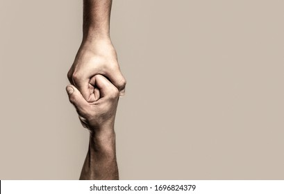 Helping hand outstretched, isolated arm, salvation. Close up help hand. Two hands, helping arm of a friend, teamwork. Helping hand concept and international day of peace, support.