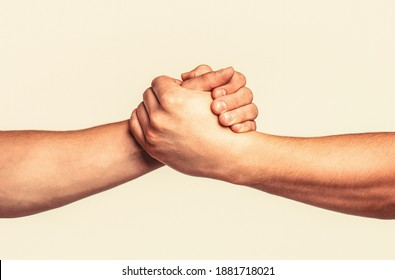 Helping hand outstretched, isolated arm, salvation. Friendly handshake, friends greeting, teamwork, friendship. Rescue, helping gesture or hands. Two hands, helping arm of a friend, teamwork.