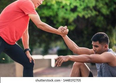 Helping hand outstretched for salvation . Strong hold. Running man helping his friend. Man help each other to run on the running track.