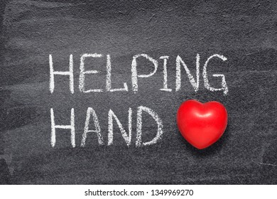 helping hand phrase written on chalkboard with red heart symbol