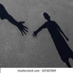Helping Hand with a shadow of an adult hand offering help or therapy to a child in need as an education concept of charity towards needy kids and teacher guidance to students who need tutoring.
