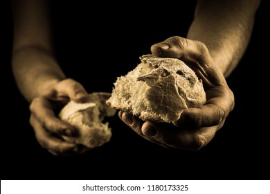 Helping hand sharing bread. Man giving Bread, Helping Hand Concept. Aged Photo Amber