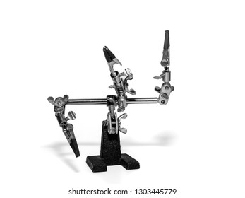 helping hand, third hand or auxiliary clip tool, platinum holder in front of a white background.